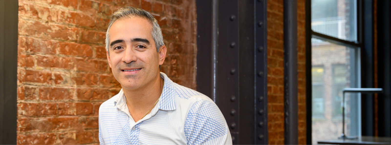 employee Juan Ruiz smiling