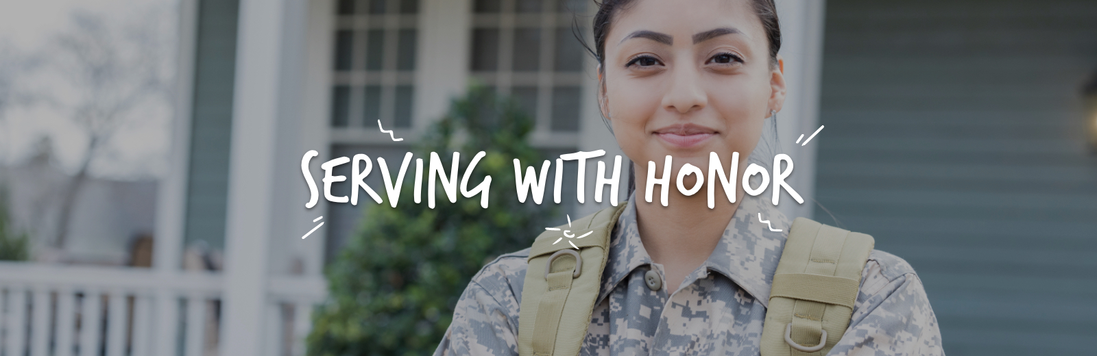 Serving with honor, women in military uniform smiling